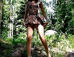 Cute girlie on a picnic has to urinate in forest