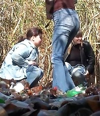 Four women pissing and chatting outdoors