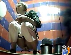 Two girls watering the spy cam planted in toilet