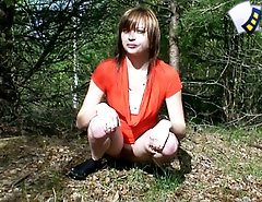 Teen in a sexy red outfit piddling in the bush