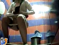 Two babes pissing in a spycammed public toilet