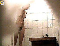 Young doll grooms her slit in spycammed showers