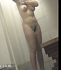 Spy after slick cutie shaving her pussy in shower
