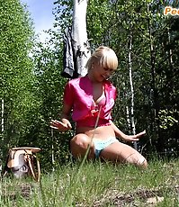 Blondie takes panties off and squats down in woods
