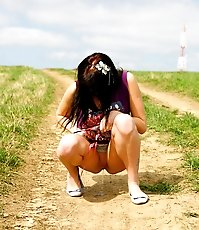 Emo chick pissing in the middle of a country road