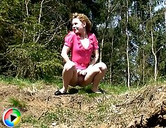 Blonde young cutie goes into bushes for a piss