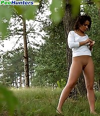 Raunchy schoolgirl does a number one in the woods