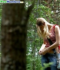 Blonde cutie empties her bladder in the forest