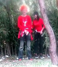 A couple of peeing babes in red caught on spy camera