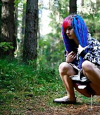 Young cutie empties her bladder in the forest
