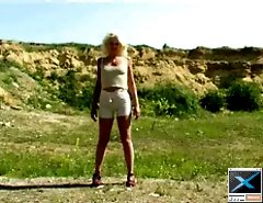 Chubby blonde peeing standing outdoor