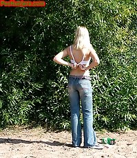 Blonde teen peeing on the river beach