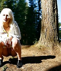Shameless young blonde tart caught peeing on forest path