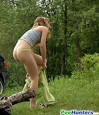 Posh hoochie takes a stop in the woods to piss