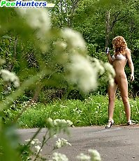 Shameless blonde lass peeing onto the blacktop