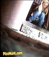 Blonde babe pissing in a spycammed park toilet