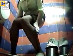 Two chicks emptying her bladder in public toilet