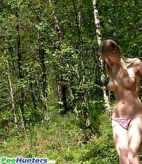 Nude puss playing watersports deep in the woods