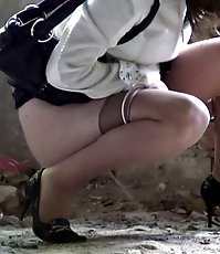 Pretty girl in pantyhose caught on tape doing a piss