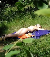 Blonde tart pisses outdoors and sunbathes naked
